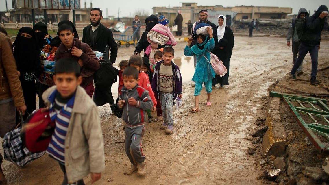 Displaced Iraqis flee their homes on a rainy day as Iraqi forces battle with ISIS, in western Mosul, Iraq March 18, 2017. (Reuters)