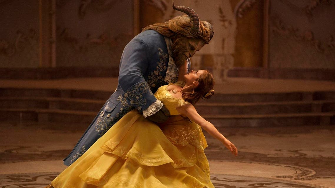 """This image released by Disney shows Dan Stevens as The Beast, left, and Emma Watson as Belle in a live-action adaptation of the animated classic """"Beauty and the Beast."""" (Disney via AP)"""