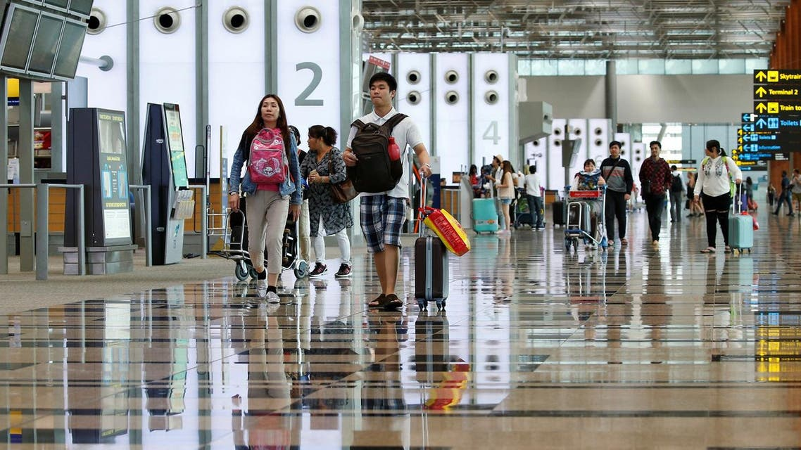 Passengers walk in Singapore's Changi Airport Terminal 3 August 17, 2016. (File Photo: Reuters)