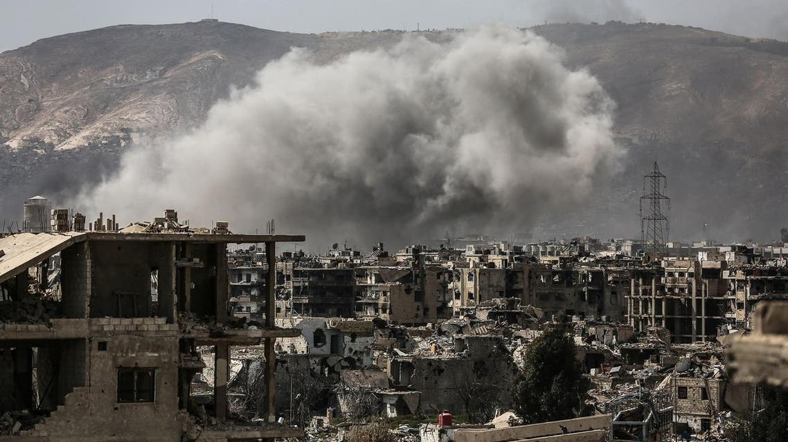 Smoke billows following a reported air strike in the rebel-held parts of the Jobar district. (AFP)