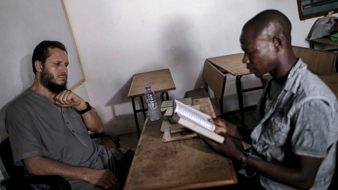 Abdul Ghani Bandenjki, left, teaches Arabic and the Quran, in a School in Tema, Ghana. Saturday, March.18, 2017. (AP)