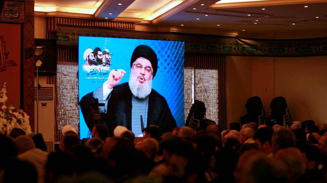 Lebanon's Hezbollah leader Hassan Nasrallah addresses his supporters through a screen during a rally in Jebshit village, southern Lebanon. (File Photo: Reuters)