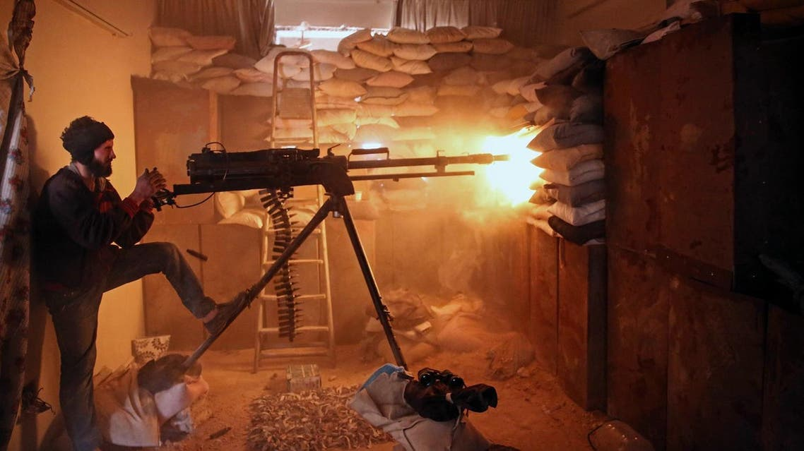 An opposition fighter from the Failaq al-Rahman brigade fires a heavy machine gun in Jobar, a rebel-held district on the eastern outskirts of the Syrian capital Damascus, on March 19, 2017. (AFP)