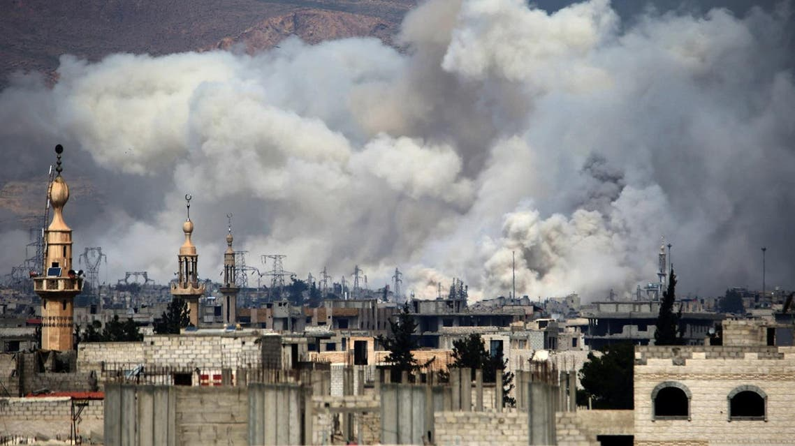 Smoke billows following reported air strikes by Syrian government forces on Damascus' north eastern rebel-held al-Qaboun suburb on March 15, 2017.  (AFP)