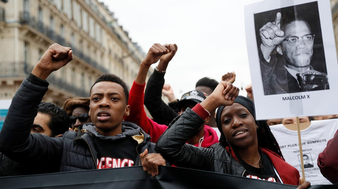 People take part in a demonstration called by the families of the victims of alleged police brutality. (AFP)