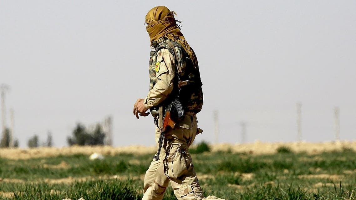 A member of the US-backed Syrian Democratic Forces (SDF), made up of an alliance of Arab and Kurdish fighters, walks in the village of Sabah al-Khayr on the northern outskirts of Deir Ezzor as they advance to encircle the Islamic State (IS) group bastion of Raqa on February 21, 2017. The SDF made a major incursion into the oil-rich province of Deir Ezzor as part of their push for Raqa, field commander Dejwar Khabat said. (AFP)