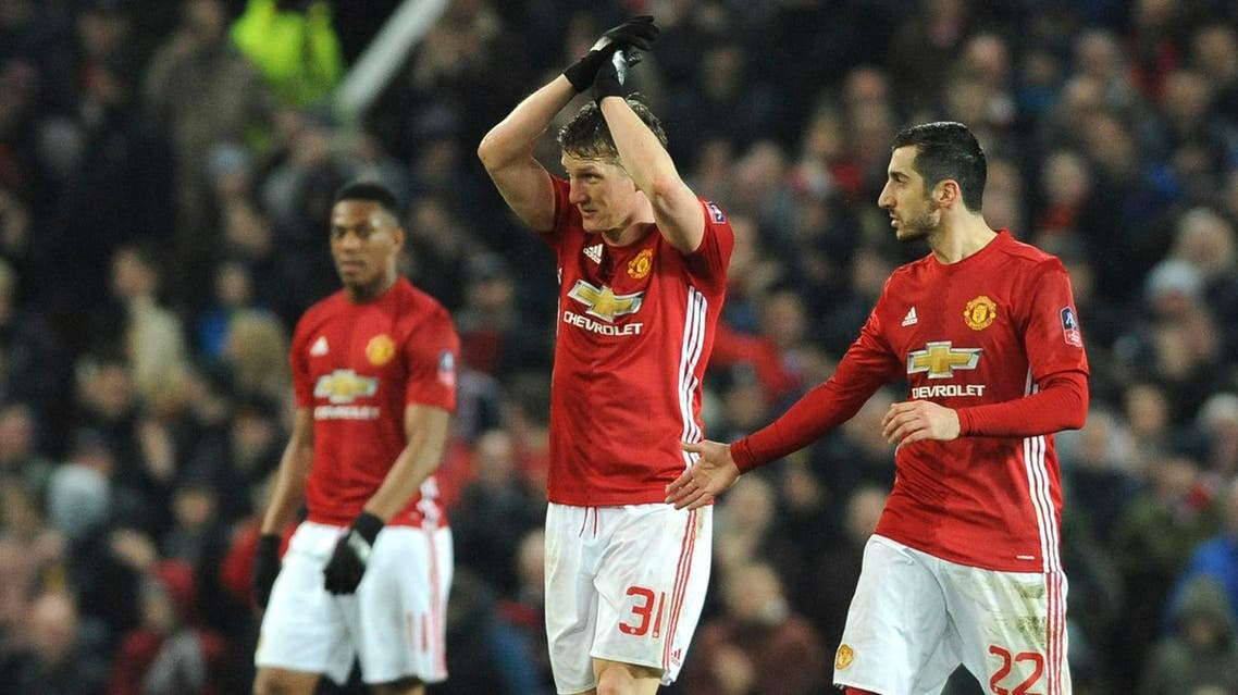 Manchester United's Bastin Schweinsteiger, centre, celebrates with Manchester United's Henrikh Mkhitaryan, right, after scoring during the English FA Cup Fourth Round soccer match between Manchester United and Wigan Athletic at Old Trafford in Manchester, England, Sunday, Jan. 29, 2017. (AP)