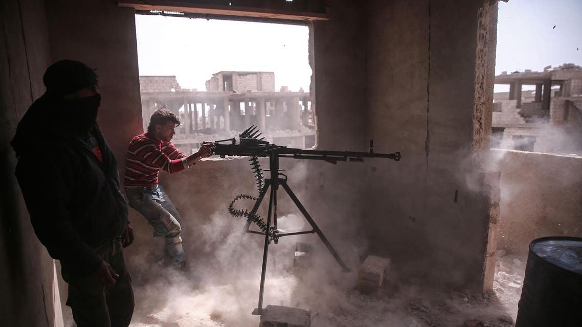An opposition fighter from the Failaq al-Rahman brigade fires a heavy machine gun in Jobar, a rebel-held district on the eastern outskirts of the Syrian capital Damascus, on March 19, 2017