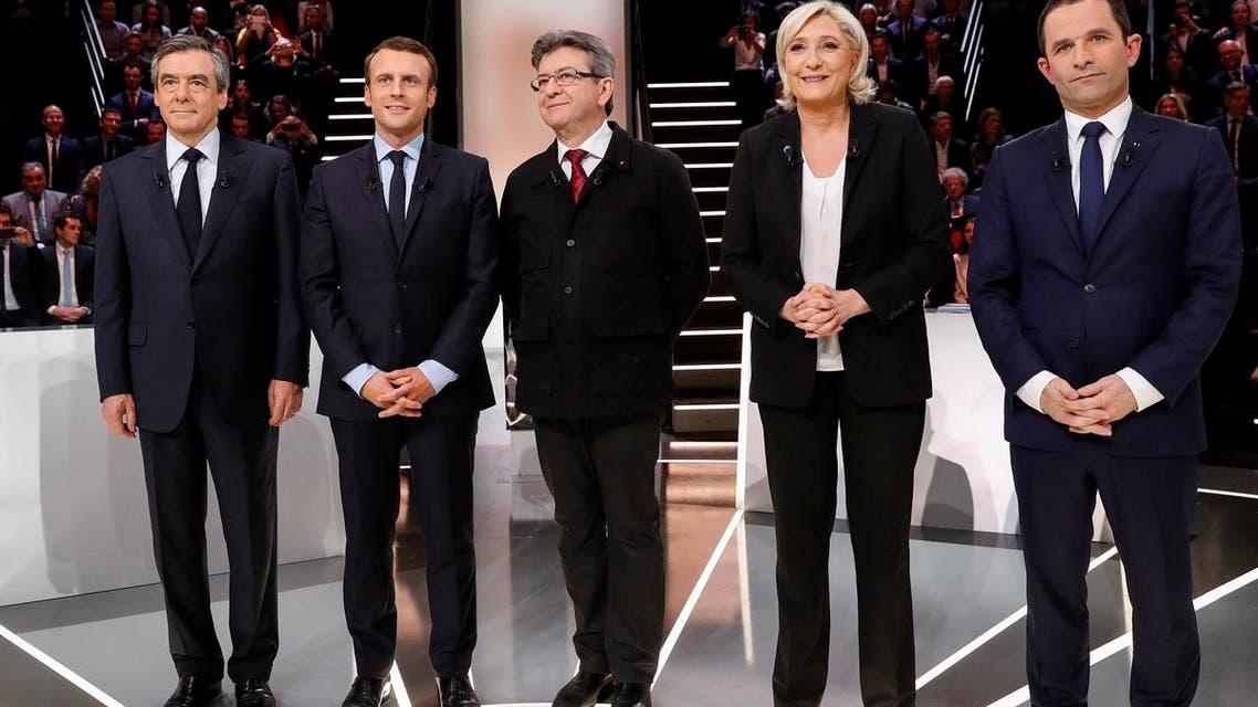 Candidates for the 2017 French presidential election (LtoR) Francois Fillon,, Emmanuel Macron, Jean-Luc Melenchon, Marine Le Pen, and Benoit Hamon pose before a debate organized by French private TV channel TF1 in France, March 20, 2017. (Reuters)