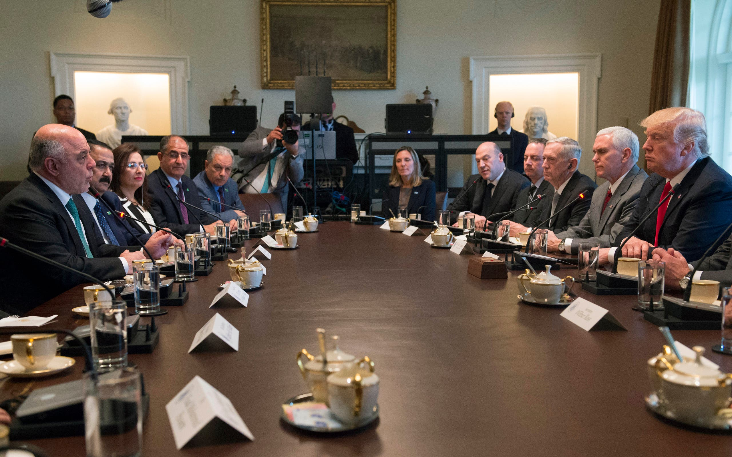US President Donald Trump listens while Iraqi Prime Minister Haider Al-Abadi speaks during their meeting in the Cabinet Room in the White House on March 20, 2017, in Washington, DC. AFP