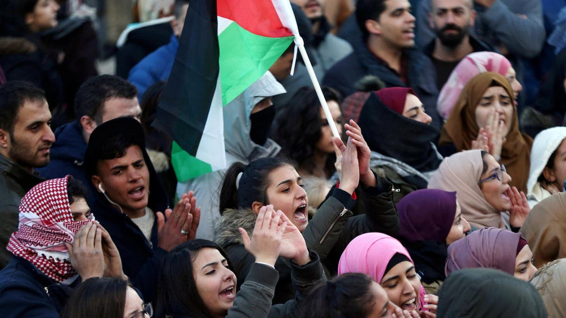 Palestinians take part in a protest against the Palestinian authority, in the West Bank city of Ramallah, March 13, 2017