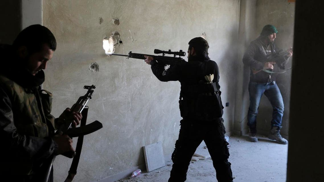 A fighter from the Free Syrian Army's Tahrir al Sham militant group aims his rifle in Damascus. (File Photo: Reuters)
