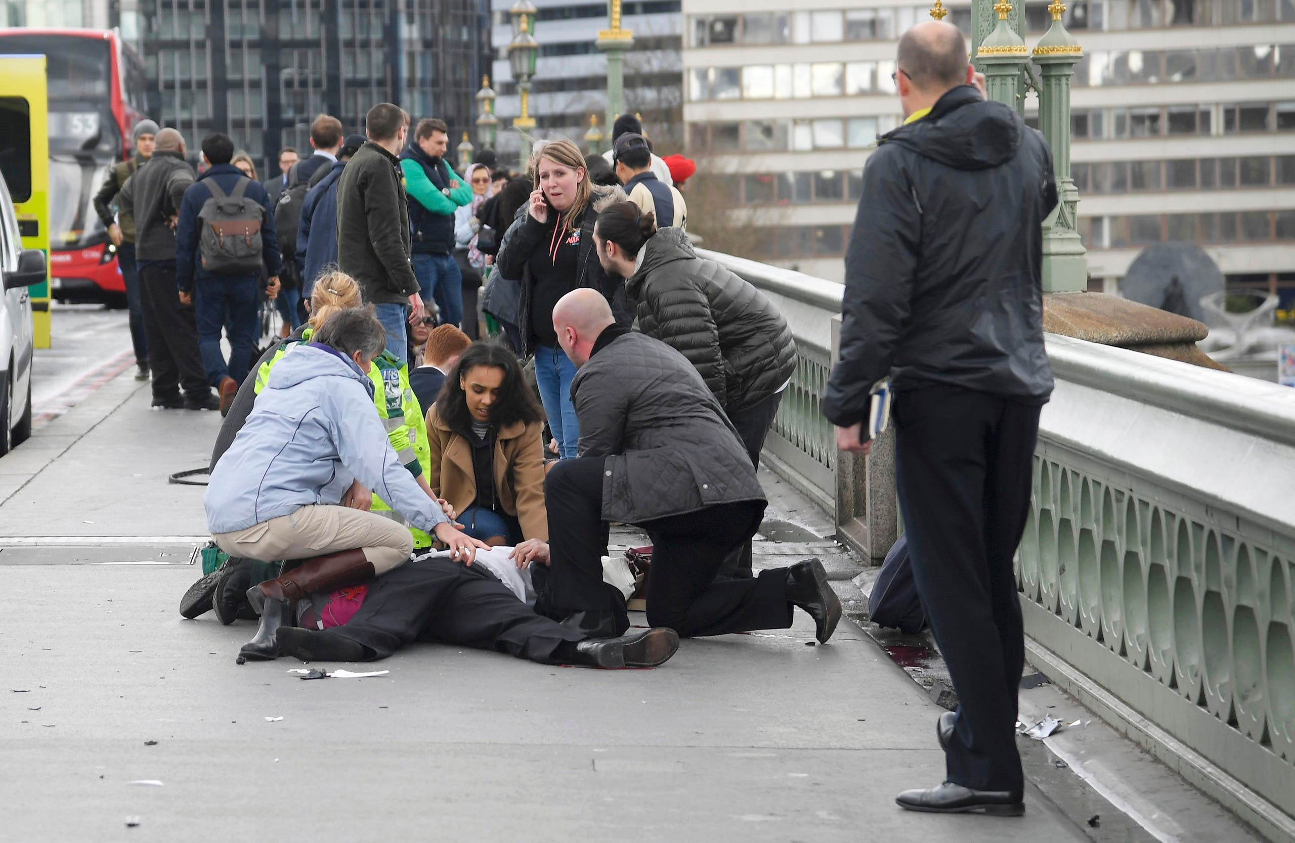 Injured people are assisted after an incident on Westminster Bridge in London, March 22, 2017. (Reuters)