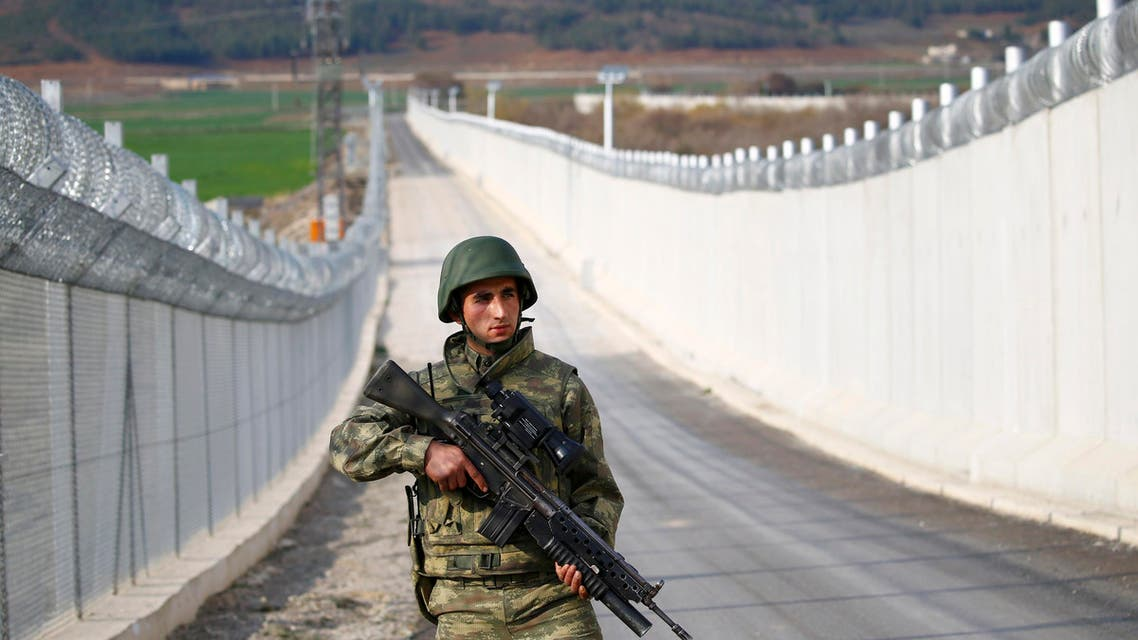 A Turkish soldier patrols along a wall on the border line between Turkey and Syria near the southeastern city of Kilis, Turkey, March 2, 2017