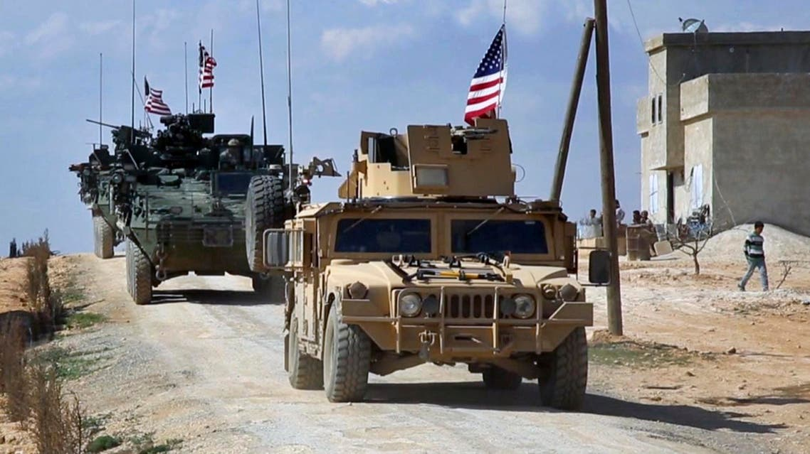 This Tuesday, March 7, 2017 frame grab from video provided by Arab 24 network, shows U.S. forces patrol on the outskirts of the Syrian town, Manbij, a flashpoint between Turkish troops and allied Syrian fighters and U.S.-backed Kurdish fighters, in al-Asaliyah village, Aleppo province, Syria. (AP)