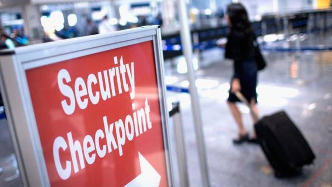 A sign directs travelers to a security checkpoint staffed by Transportation Security Administration (TSA) workers at O'Hare Airport on June 2, 2015 in Chicago