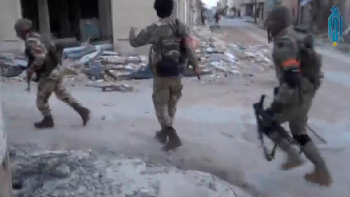 A still image taken from a video uploaded on social media on March 22, 2017, purports to show Tahrir al-Sham rebel fighters running with their weapons, said to be in Soran district, near Hama, Syria. (Reuters)