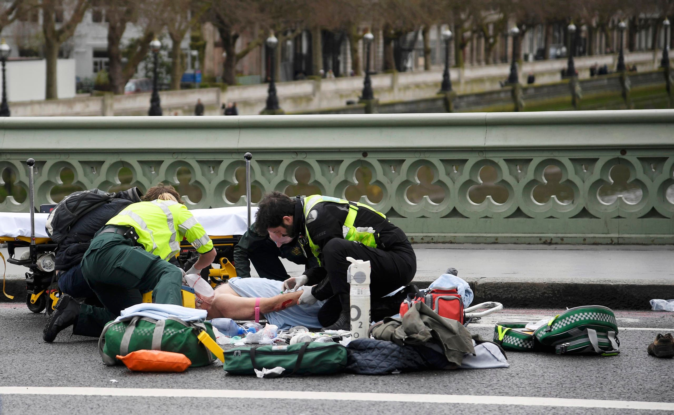 Paramedics treat an inured person after an incident on Westminster Bridge in London, March 22, 2017. reuters