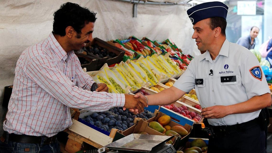 Belgian police officer Tarek Chatt talks to a man selling fruits and vegetables during a patrol at a market in, Belgium. (File Photo: Reuters)