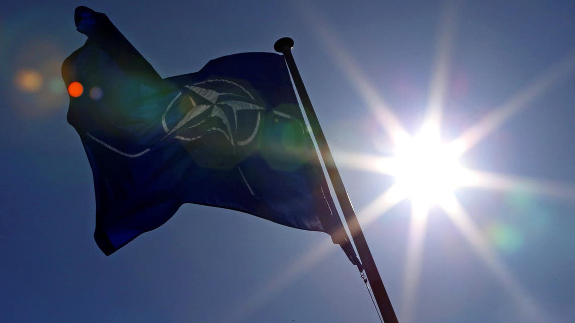 A NATO flag flies at the Alliance's headquarters in Brussels, March 2, 2014