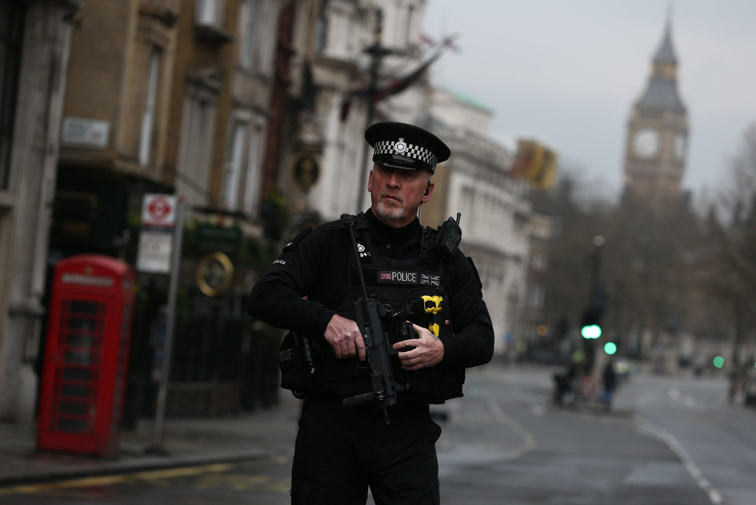 An armed police officer stands on Whitehall the morning after an attack by a man driving a car and weilding a knife left five people dead and dozens injured, in London, Britain, March 23, 2017.(Reuters )