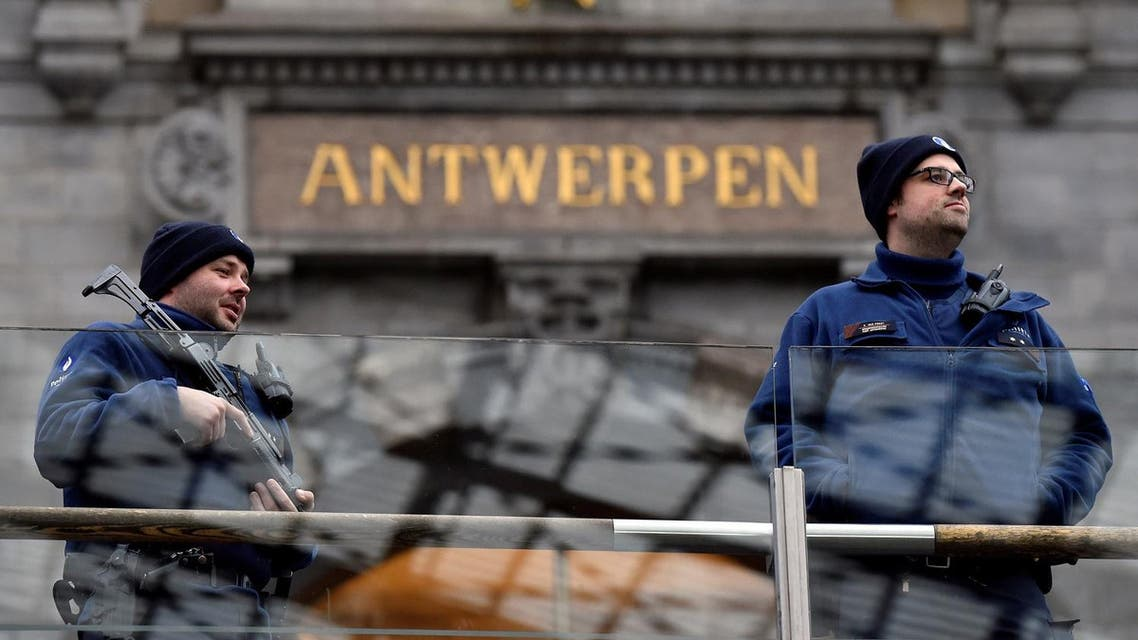 Belgian police officers patrol in the central station, in Antwerp, Belgium March 3, 2017. REUTERS/Eric Vidal