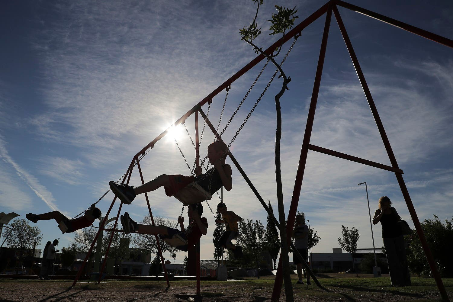 Syrian migrant children play in a park in the town of La Punta, San Luis, Argentina. (AP)