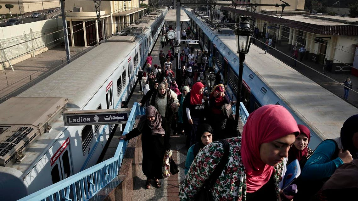 Egyptian women exit a metro station in Cairo. Egypt doubled the price of tickets to 2 Egyptian pounds, effective from Friday. (File photo: Reuters)
