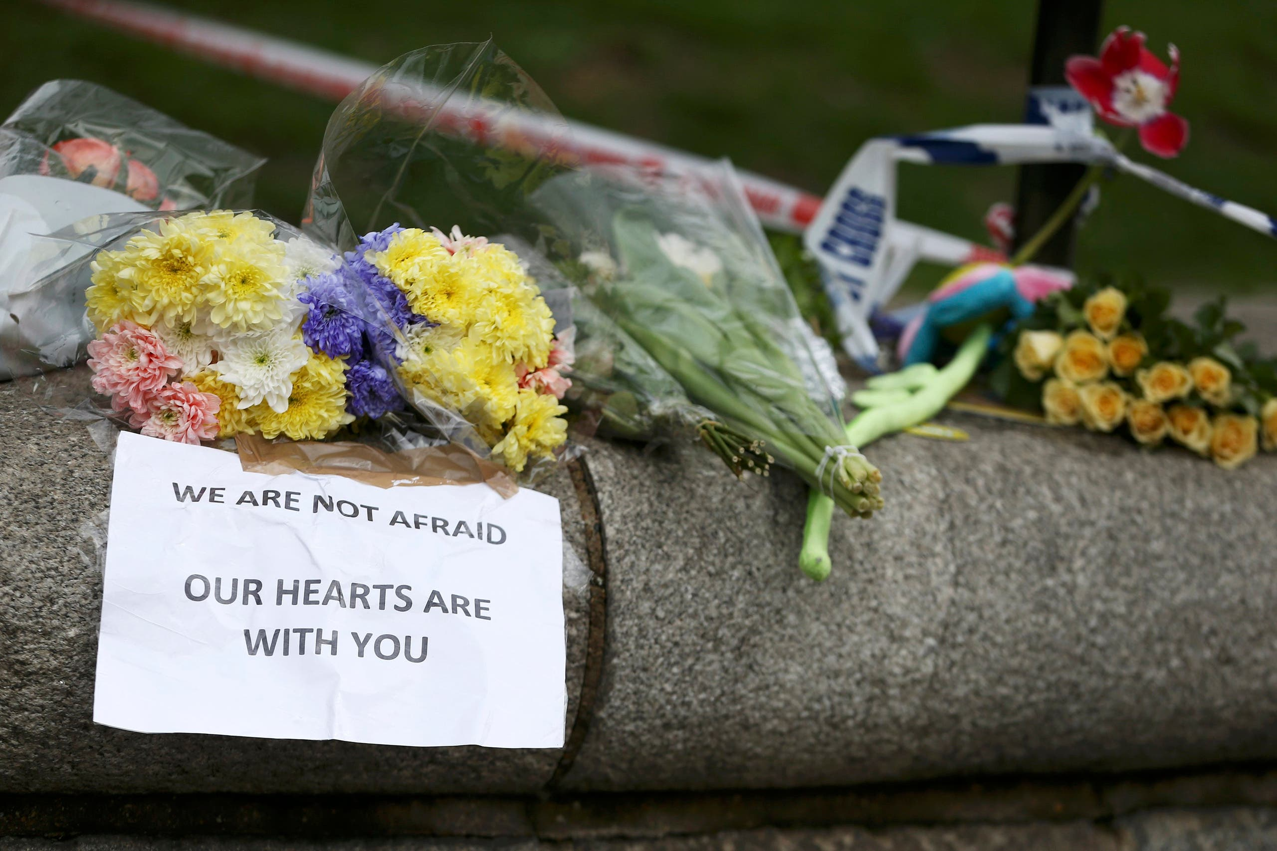 Flowers and messages are left near the scene of an attack by a man driving a car and weilding a knife left five people dead and dozens injured, in London, Britain, March 23, 2017. reuter