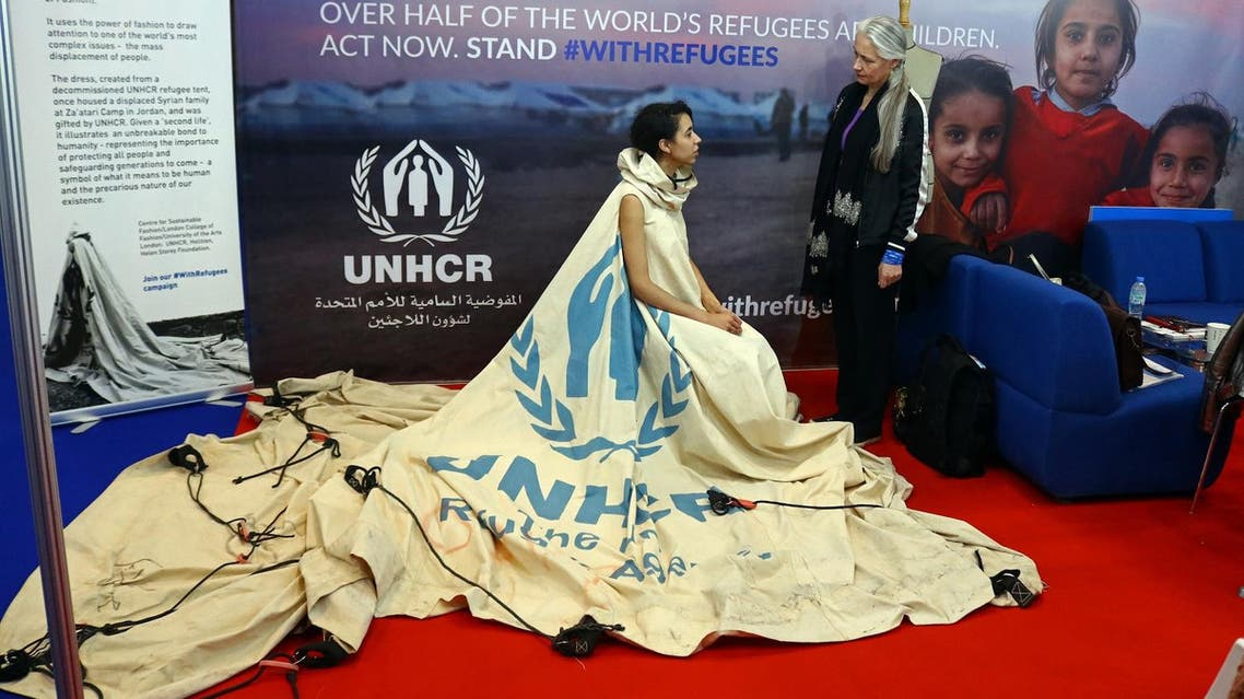 """Project ambassador of """"Dress For Our Time"""" Louise Owen models a UN tent from the Zaatari camp in Jordan that has been converted into a dress by fashion academic Helen Storey (R) at the Dubai Humanitarian Aid and Development conference and Exhibition in Dubai on March 22, 2017. afp"""
