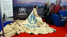 Syrian refugee tent finds life as dress with a past