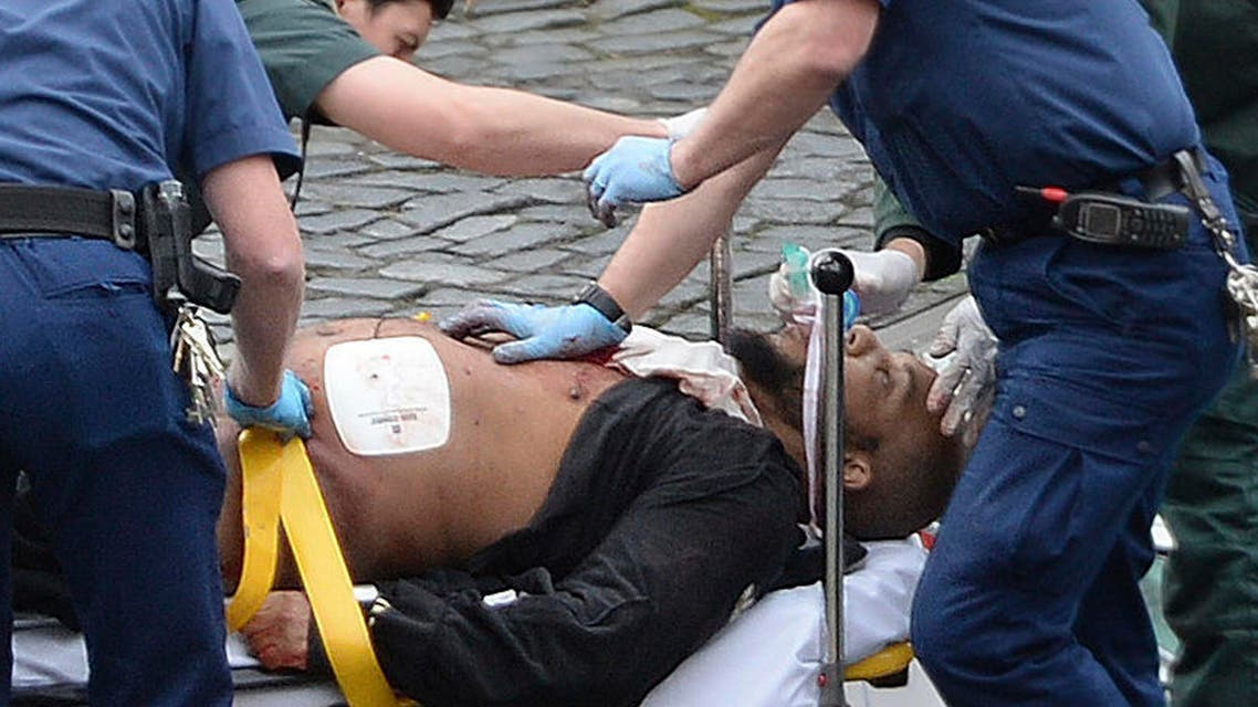 An attacker is treated by emergency services outside the Houses of Parliament London, Wednesday, March 22, 2017. AP