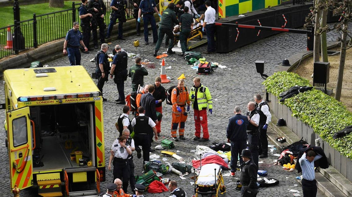 Emergency services at the scene outside the Palace of Westminster, London. (AP)