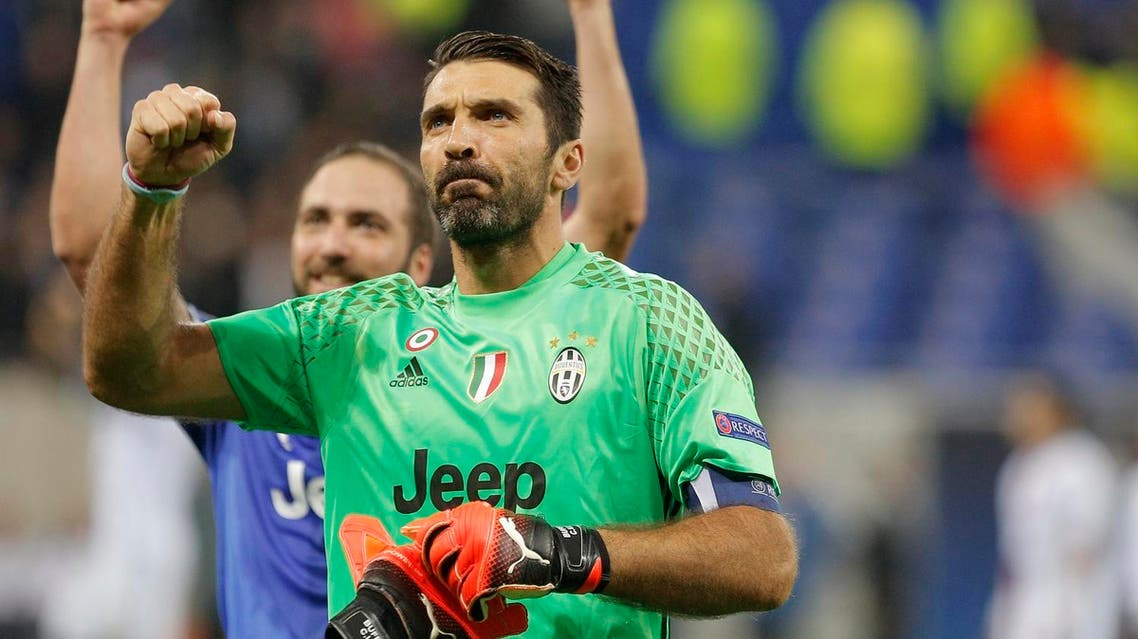 Juventus goalkeeper Gianluigi Buffon clenches his fist after the Champions League Group H soccer match against Lyon, Tuesday Oct. 18, 2016, in Lyon, central France. Juventus won 1-0. (AP)