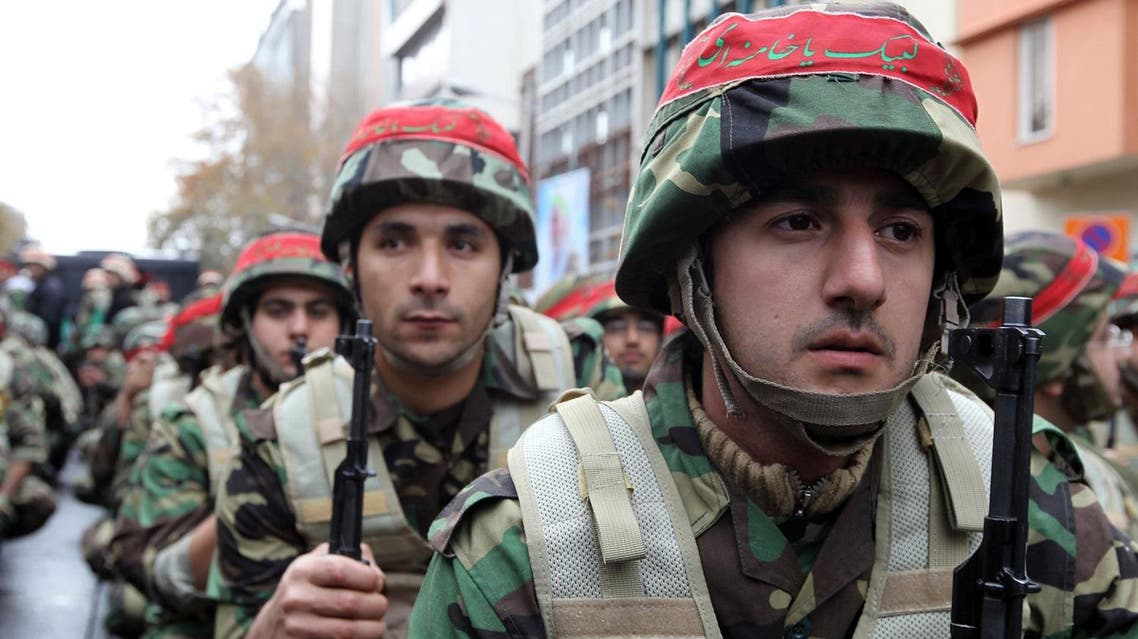 Members of Iran's paramilitary Basij militia parade in front of the former US embassy in Tehran on November 25, 2011 to mark the national Basij week. (AFP)