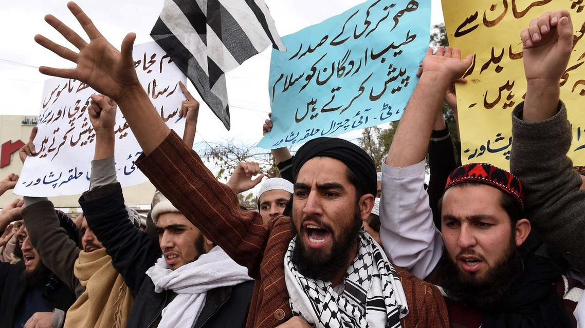 Pakistani supporters of religious political party Jamiat Ulema-e-Islam Fazl (JUI-F) shout slogans during a protest against the printing of satirical sketches of the Prophet Mohammed by French magazine Charlie Hebdo in Peshawar on January 22, 2015. (AFP)