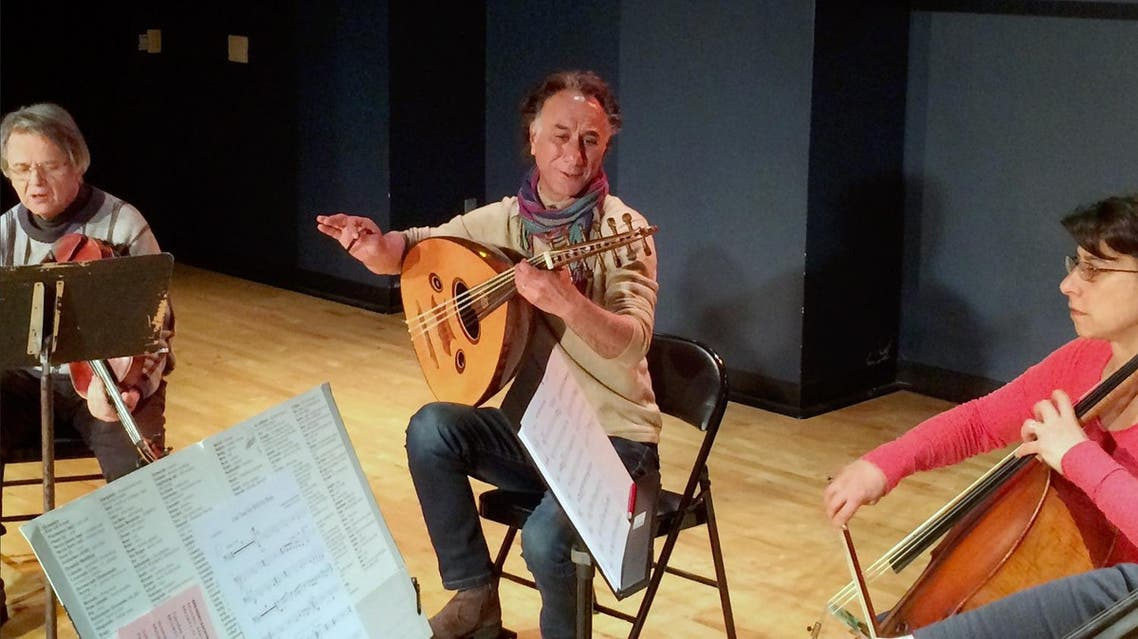 Iraqi American composer and musician Rahim AlHaj, center, rehearses in Dearborn, Mich., Thursday, March 23, 2017. (AP)