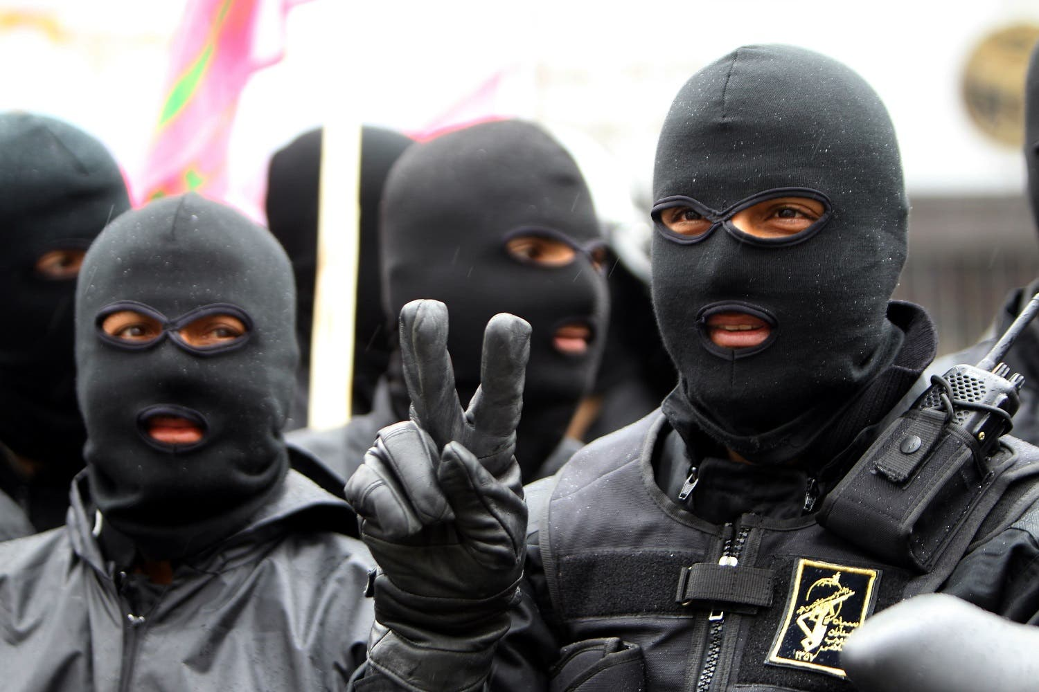 Masked members of Iran's paramilitary Basij militia parade in front of the former US embassy in Tehran on November 25, 2011 to mark the national Basij week. (AFP)