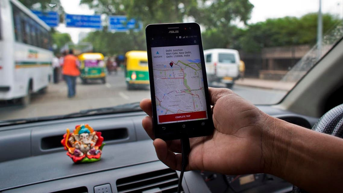 An Indian cab driver displays the city map on a smartphone provided by Uber as he drives in New Delhi, India, Friday, July 31, 2015. (AP)