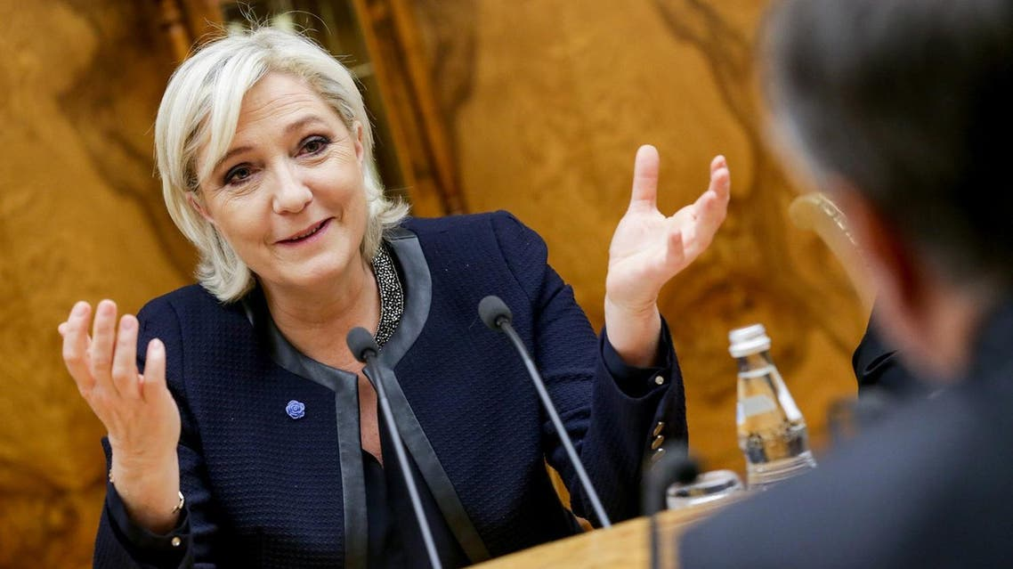 A handout picture taken on March 24, 2017 and provided by Russia's State Duma PR department shows Russia's parliament speaker Vyacheslav Volodin (R) and French presidential election candidate for the far-right Front National (FN) party Marine Le Pen during their meeting at the State Duma building, Russia's lower house of parliament, in Moscow on March 24, 2017. AFP