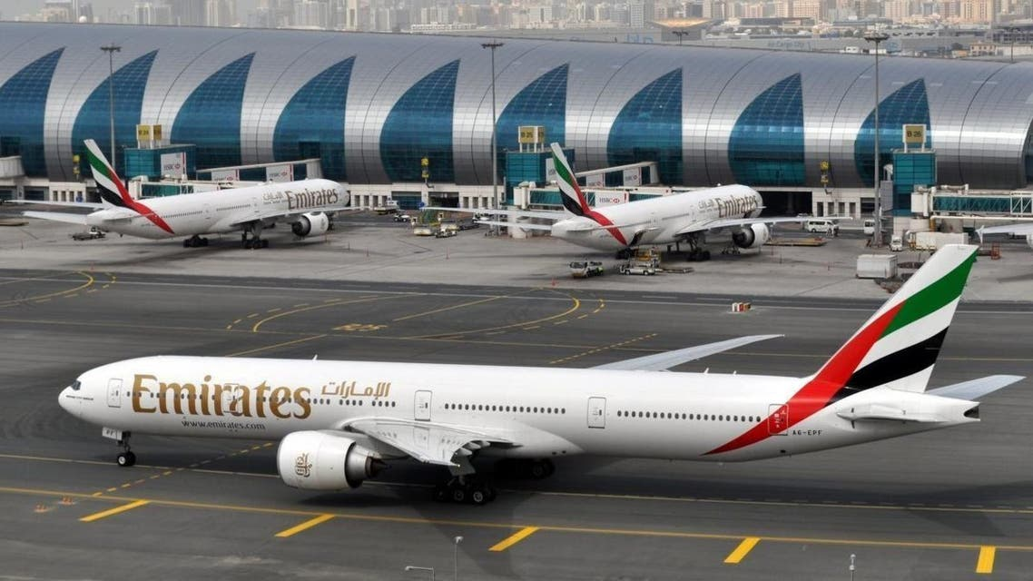 An Emirates plane taxis to a gate at Dubai International Airport at Dubai International Airport in Dubai, United Arab Emirates, on Wednesday, March 22, 2017. The president of the Middle East's biggest airline says a ban on electronics other than mobile phones in the cabins of U.S.-bound flights came as a complete surprise as he defended security measures at its Dubai hub. (AP Photo/Adam Schreck)