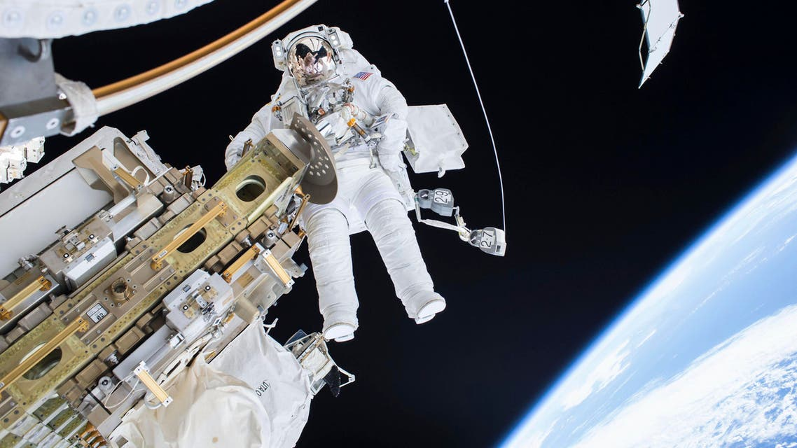 Expedition 46 Flight Engineer Tim Kopra performs a spacewalk outside the International Space Station in this December 21, 2015 NASA handout photo. (Reuters)