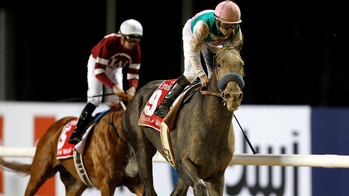 Mike Smith rides Arrogate to the finish line to win the ninth and final race of the Dubai World Cup on Saturday, March 25, 2017.. (Reuters)