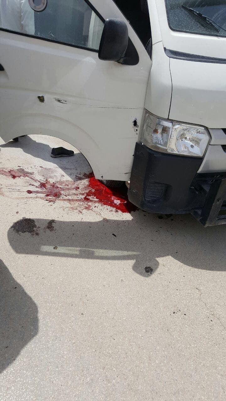 Blood on the road at the scene of the robbery in Riyadh