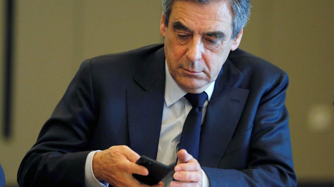Francois Fillon, former French Prime Minister, member of the Republicans political party and 2017 presidential election candidate of the French centre-right checks his phone, few hours before a campaign rally in Biarritz, in Anglet, France, March 24, 2017