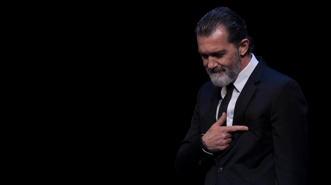Spanish actor Antonio Banderas gestures after receiving the honorary Gold Biznaga award during the 20th International Malaga Film Festival in Malaga on March 25, 2017.  (AFP)