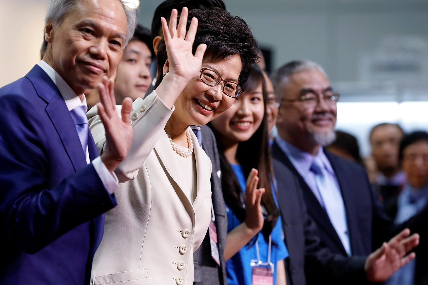 Carrie Lam waves during news conference in Hong Kong. (Reuters)