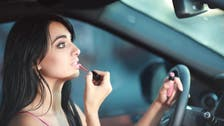Dubai motorists face fines for applying makeup while driving, allowing small children in front seat