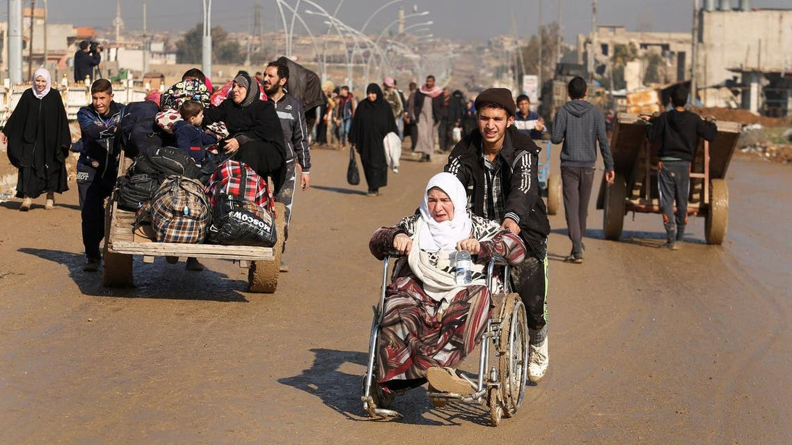 Displaced Iraqis flee their homes as Iraqi forces battle with ISIS, in western Mosul, Iraq March 24, 2017. (Reuters)