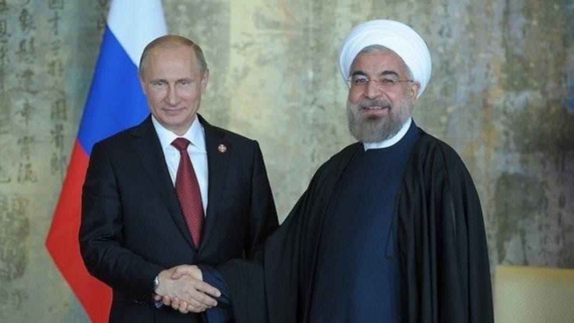 لقاء سابق بين روحاني وبوتين